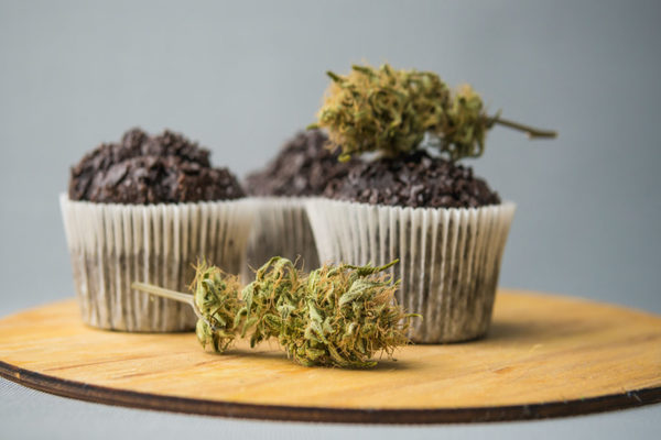 Homemade Cakes With Cannabis And Buds Of Marijuana. Concept Of U